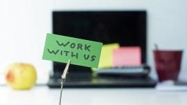 work with us written on a memo at the office