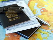 Passport with business travel necessities on the map
